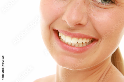 Closeup of a beautiful young woman smiling, isolated on white
