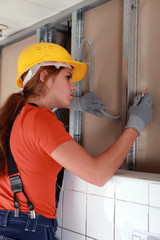 Female electrician working on wiring