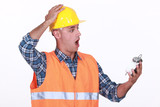 Shocked builder looking at alarm clock