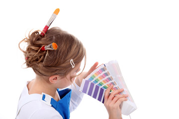 female painter holding colour chart