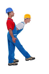Two laborer standing in shape of K letter