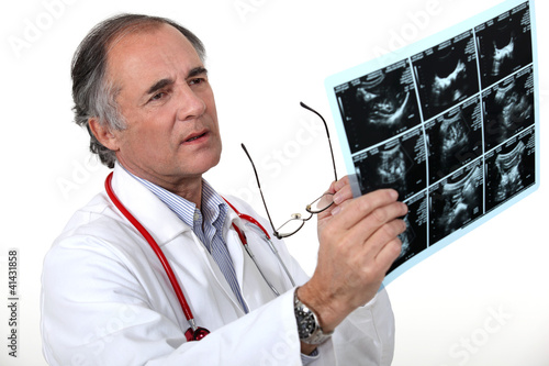 Doctor examining a scan