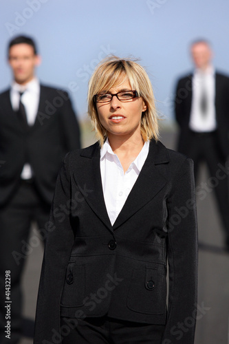 Portrait of a blond woman standing outdoors