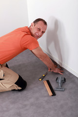 Man laying linoleum
