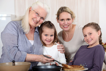 family making crepes surrounded