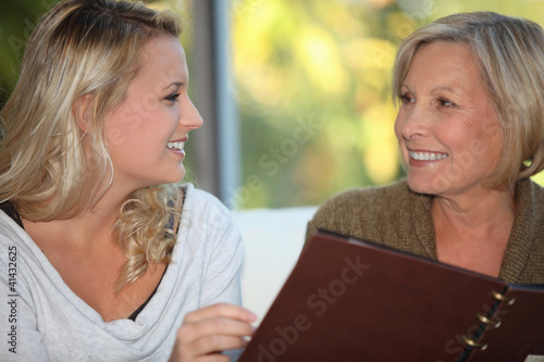 young woman and older woman at restaurant