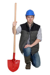 Worker clutching shovel
