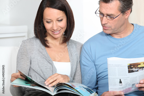couple reading magazines