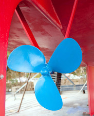 blue sailboat propeller in a red hull