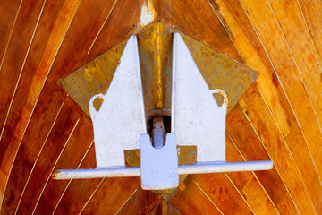 anchor detail in silver color on a wooden hull