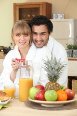 Couple having breakfast in your bathrobe