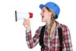 Woman laborer screaming in a bullhorn
