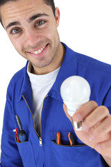 happy electrician in jumpsuit holding bulb