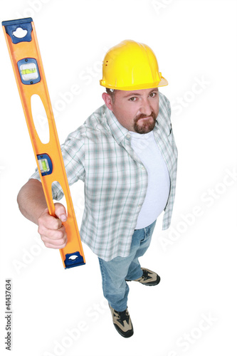Builder brandishing a spirit level