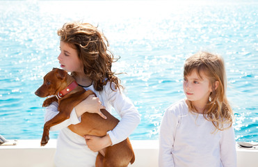 sister kid girls with dog on the sea