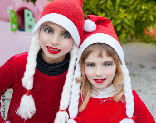 Christmas santa costumer kid girls portrait smiling