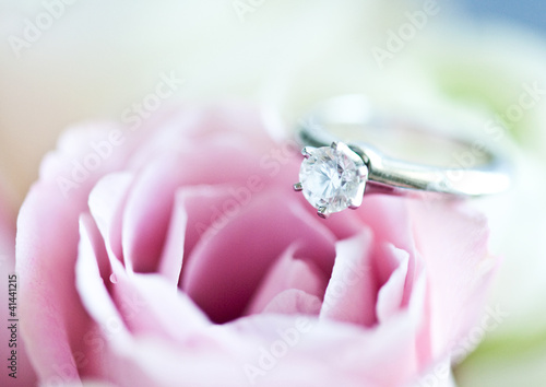 Diamond engagement ring and a rose