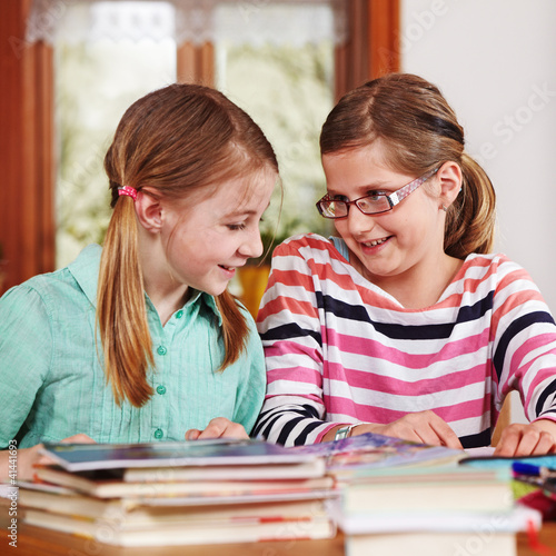two teenage girls doing homework