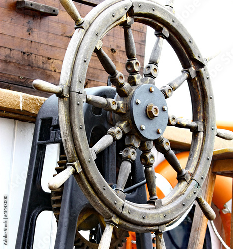 Close up of a steering wheel of the ship