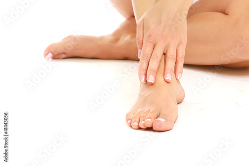 Female feet isolated on white