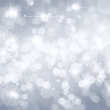 Silver defocused lights background with copy space