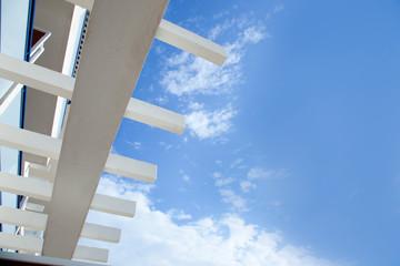 Blue sky with mediterranean white beams