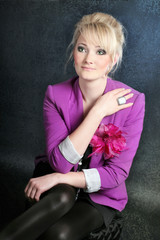 Business look of young Slavonic stylish girl with blond hair