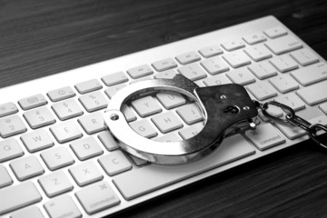 Keyboard with handcuffs