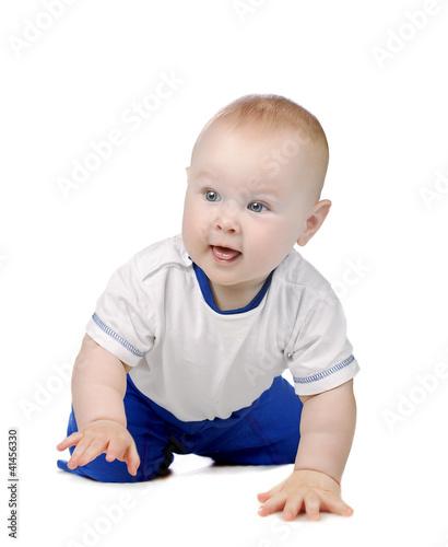 Cute blond baby boy crawls