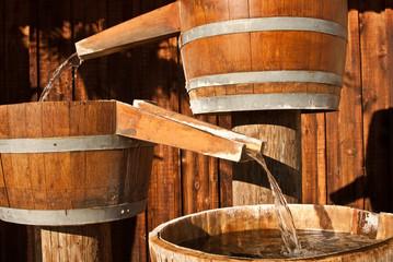 Water flowing from barrels