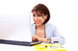 Smiling woman looking at laptop or reading an email