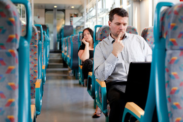Pensive businessman working on the train