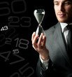 Businessman holding a hourglass
