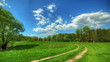 spring landscape with a rural road. HDR timelapse.