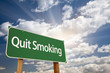 Quit Smoking Green Road Sign and Clouds