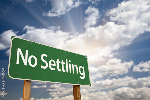 No Settling Green Road Sign and Clouds
