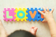Toddler constructing the word Love