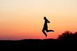 silhouette of ma dancing in sunset