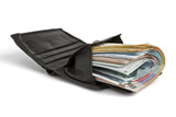many banknotes in black wallet