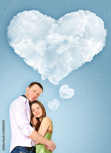 Portrait of young couple standing together and embracing. Blank