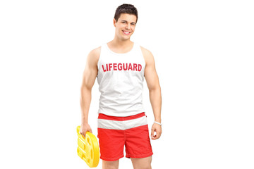 A smiling lifeguard on duty posing