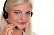 Frau mit Headset Telefon im Call Center