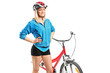 Female biker with helmet posing next to a bike