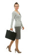 Modern business woman with briefcase walking