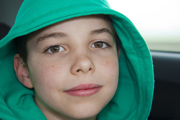 closeup of cute young teen boy in green hood