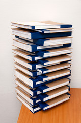 A stack of folders, documents, neatly lying on the office desk