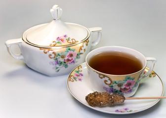 Antique crockery with tea and sugar stick