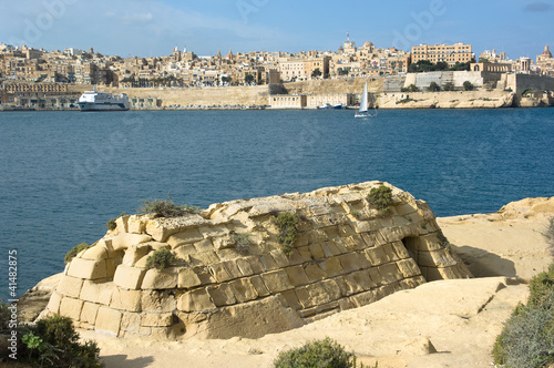 skyline of Valletta from Kalkara, in the foreground an old storage building constructed of sandstone blocks, Malta