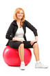 Portrait of a mature female sitting on a pilates ball