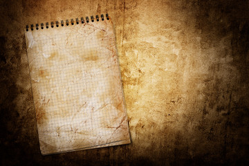 old used notebook on grunge background